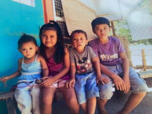 Four children sitting next to each other in the Philippines